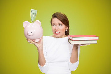 Cost of college education. Woman holding piggy bank books