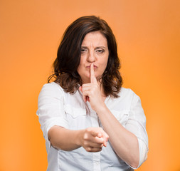 Woman asking to keep quiet, patronizing pointing at you finger