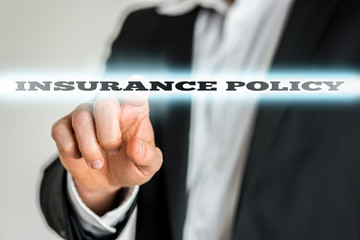 Businessman Pointing Glowing Insurance Policy Text