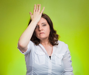 woman with palm on forehead gesture in duh moment