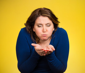 woman about to vomit isolated on yellow background
