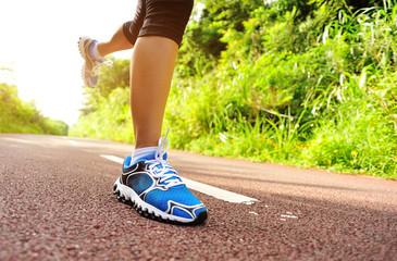 fitness woman runner  legs running on trail