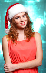 Portrait of beautiful young woman on bright blue background