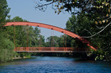 Red Bridge Extending Over the River - 71297943