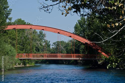 Zdjęcia na płótnie, fototapety, obrazy : Red Bridge Extending Over the River