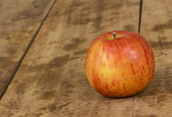 Fresh Red apple on wood table