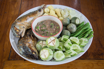 Shrimp paste with fried mackerel and vegetable on wood