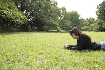 Woman listening to music in a prone position