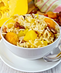 Pilaf fruit with pumpkin on board