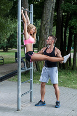 Personal trainer insuring woman during exercise