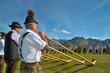 Leinwandbild Motiv Konzert mit Alphorn im Gebirge