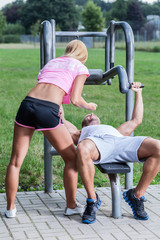 Fit woman helping boyfriend