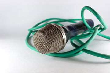 Old microphone with green cable