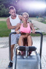 Fit woman using rowing machine