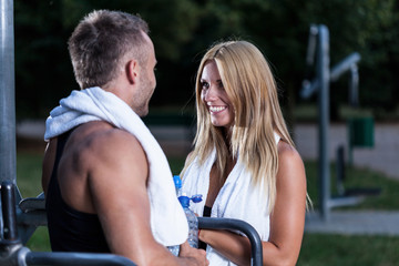 Attractive woman talking with athletic man