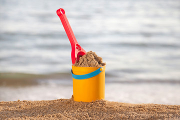Bucket and shovel in the sand at the beach