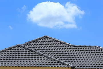 tile roof on a new house with blue sky