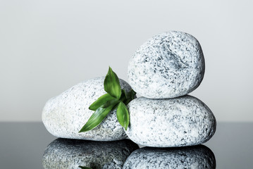 spa background with pebbles pyramid and bamboo