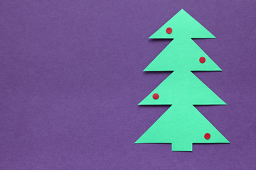 Paper Christmas tree on purple background