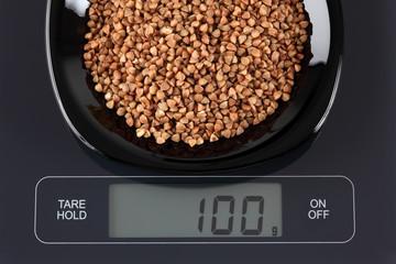 Buckwheat on kitchen scale