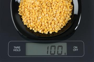 Yellow split lentils on kitchen scale