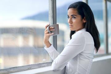 businesswoman drinking cofffee