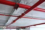 red pipeline extinguishing water in industrial building