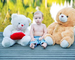 Portrait of the cute boy with toys