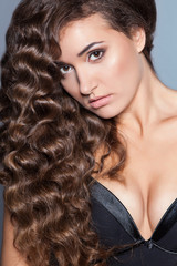 Portrait of a young brunette woman with beautiful hair