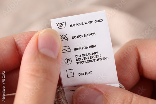 Fotobehang Stof Clothes label with cleaning instructions