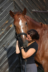 Portrait of happy woman and brown horse