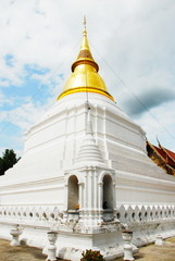 horse carriage and  temple Phrathat Lampang Luang in Lampang, Th