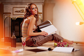 woman sitting and reading magazine indoor shot