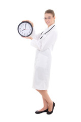 young female doctor with office clock isolated on white