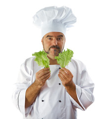 chief cook holding lettuce