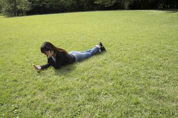 Young woman relaxing on the lawn