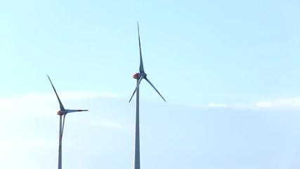 wind turbine against blue sky