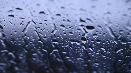 rain drops on glass window (dolly shot)