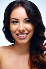 Closeup portrait of a beautiful cheerful woman with clean skin