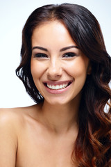 Closeup portrait of a beautiful laughing woman