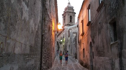 Tourists on the cobbled streets of the medieval Erice city