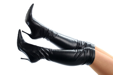 Sexy legs wearing black leather boots