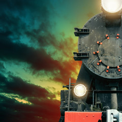 Black steam train at night