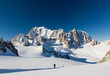 Ski mountaineers ascend the Vallee Blanche glacier. In backgroun