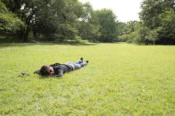 Woman sleeping in the prone position on the lawn