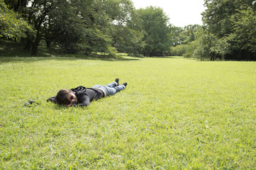 Woman sleeping in the prone position in the park