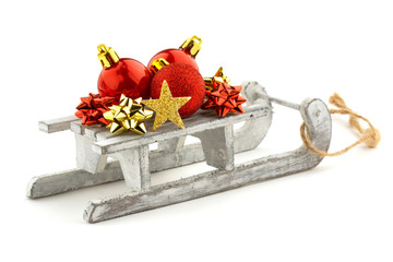 christmas baubles over a sled