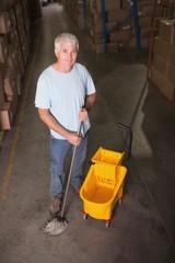 Man moping warehouse floor