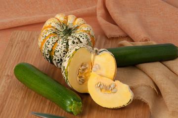 Organic Harlequin Squash. Zucchini. Wooden Board