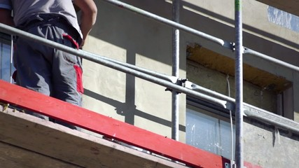 Man working on scaffolding